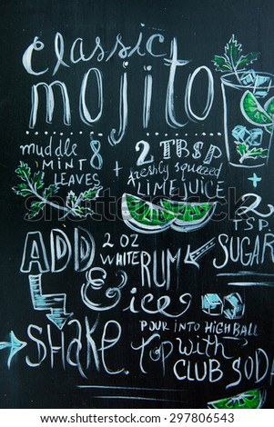 Hand drawn cocktails doodles. Mojito Chalk lettering.A variety of hand-drawn text and illustrations to compose the Mojito cocktail recipe. - stock photo