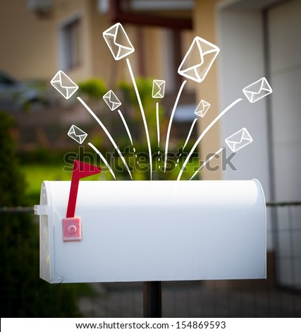 Hand drawn letters and envelopes comming out of a mailbox - stock photo