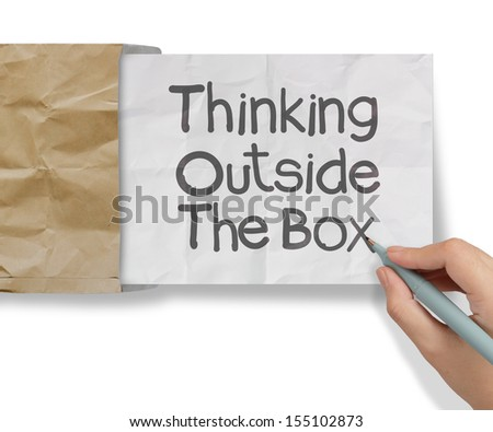 hand draws thinking outside te box on crumpled paper as concept - stock photo