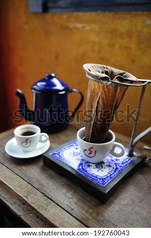 hand drip coffee in traditional way - stock photo