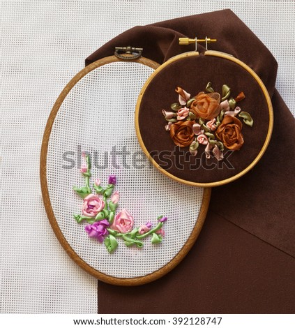 Hand embroidery satin ribbons. Process embroidery flower ornament in the hoop  - stock photo