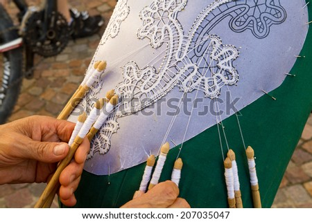 hand embroidery with lace pillow crafts ancient crafts historic medieval festival - stock photo