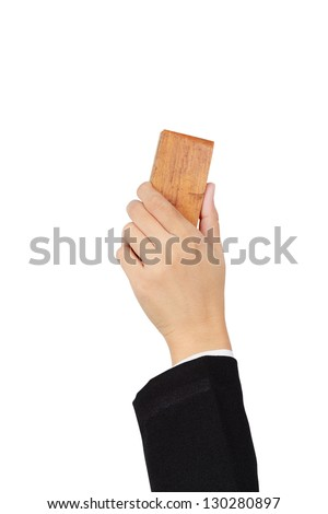 Hand erasing the whiteboard - stock photo