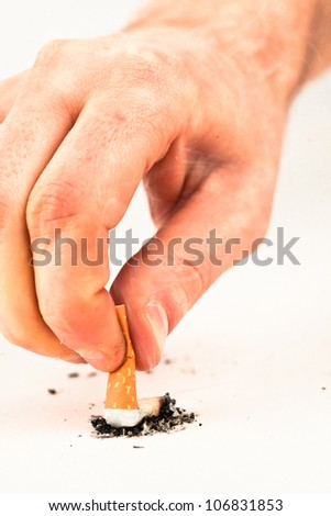 Hand extinguished a cigarette against a white background - stock photo