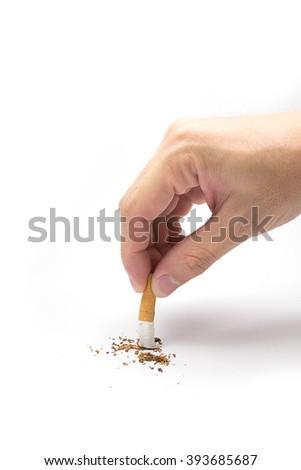 Hand extinguishing cigarette on white background. - stock photo