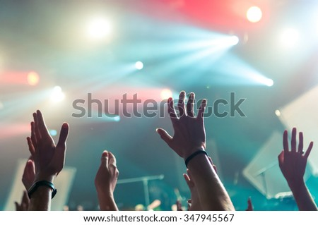 hand fans during a concert - stock photo