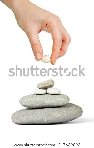 Hand finished pebble tower isolated on white  - stock photo