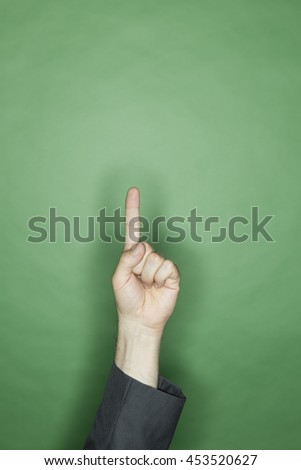 hand gesture of a male caucasian in a business suit: pointing with finger - stock photo