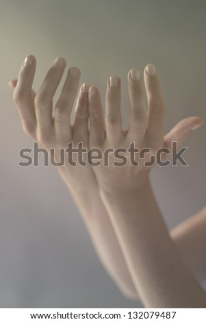 Hand Gesture Raised Hand up to the sky praising the Lord God - stock photo