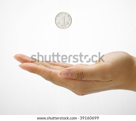 Hand gesture with one Chinese Yuan coin. Concept of development,  fortune, accumulation - stock photo