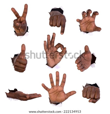 Hand gestures  through holes in paper isolated on white - stock photo