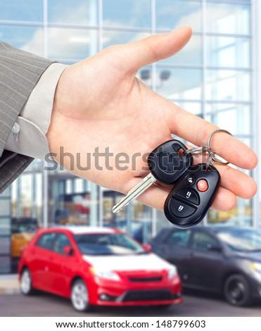 Hand giving a car key. Auto repair service. - stock photo