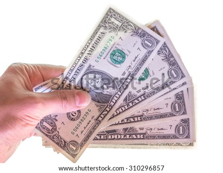 Hand giving dollar banknotes  currency of the United States  isolated over white - stock photo
