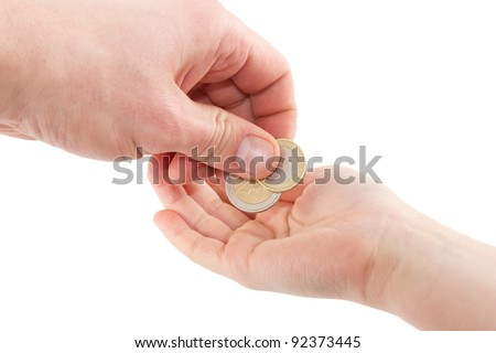 Hand giving euro coins in a hand of a child isolated on a white background - stock photo