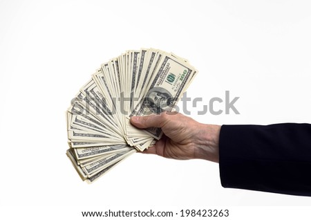 Hand giving money. Fanned one hundred dollar bills - stock photo