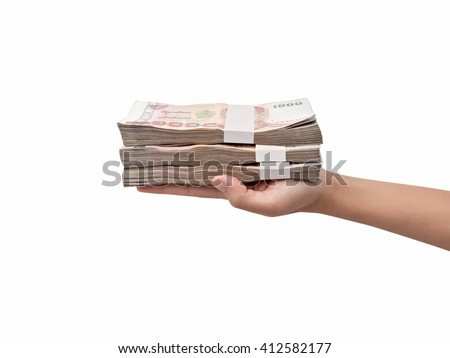 Hand giving Thai banknotes, isolated on white background - stock photo