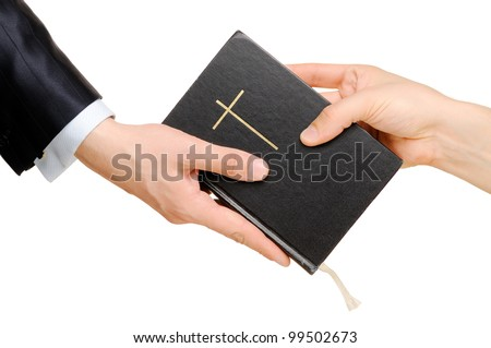 Hand giving the Bible to another person. Isolated on white - stock photo