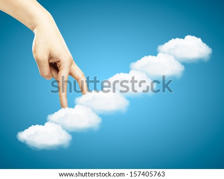 hand goes up the stairs clouds - stock photo