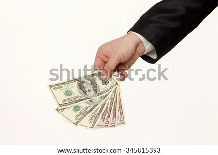 Hand handing over money isolated on white background - stock photo