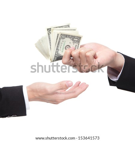 Hand handing over money to another hand isolated on white background, business concept - stock photo