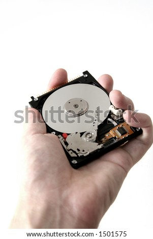 Hand-held hard drive - stock photo