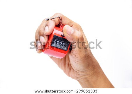 Hand held tally counter, counter clicker, counting machine - stock photo