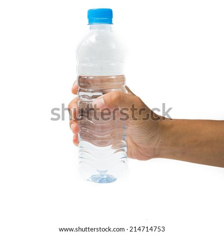 Hand hold a bottle of water. - stock photo