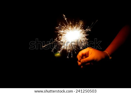 hand hold a spark fireworks - stock photo