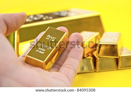 Hand hold gold bars - stock photo