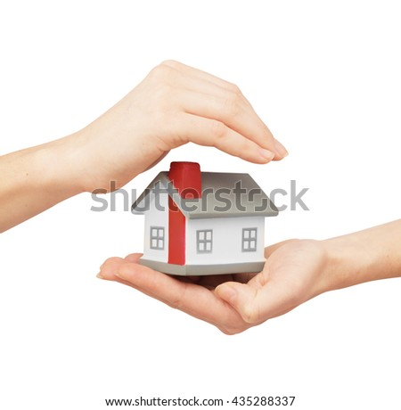hand hold home model and other hand cover home model. Toy home in hands - stock photo