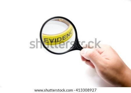 hand hold magnifying glass with yellow evidence in focus concept - stock photo