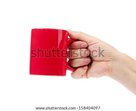 Hand hold red mug. - stock photo