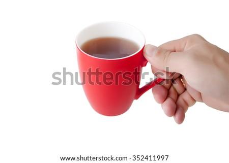 Hand hold red mug on white background.. isolated - stock photo