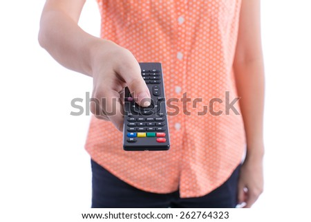 Hand hold remote control on white background - stock photo
