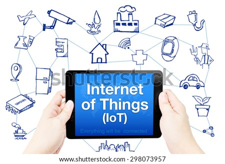 Hand hold tablet with Internet of things (IoT) word on screen with doodle icon on white background. - stock photo