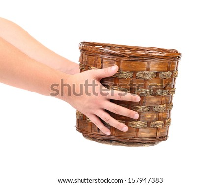 Hand hold vintage weave wicker basket isolated on a white background - stock photo