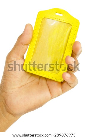 Hand hold Yellow leather tag isolated on white with save clipping path - stock photo
