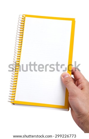 Hand holding a Blank Book close up - stock photo