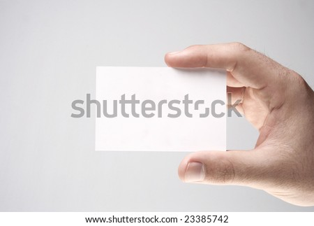 Hand holding a blank business card, Add your own text - stock photo