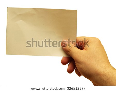 Hand holding a blank piece of paper - stock photo