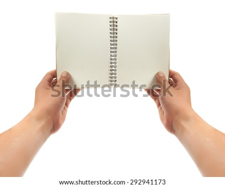 hand holding a book. isolated over white background - stock photo