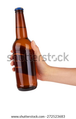 hand holding a brown beer bottle without label isolated on white background - stock photo