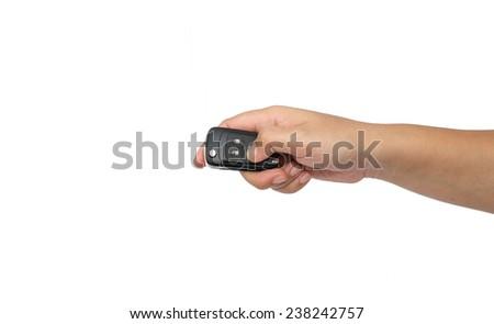 hand holding a car key isolated on white background - stock photo