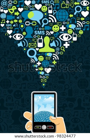 Hand holding a cell phone under social media icons on blue background - stock photo