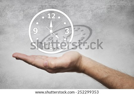 Hand holding a clock. Passing of time - stock photo