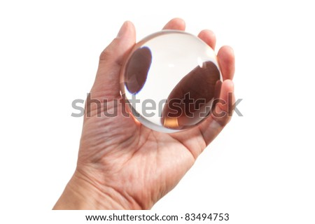 Hand holding a Crystal Ball for background - stock photo