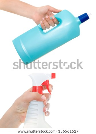 Hand holding a detergent and Spraying cleaning liquid. Isolated - stock photo
