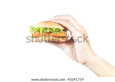 Hand  holding  a fish burger on white  background - stock photo