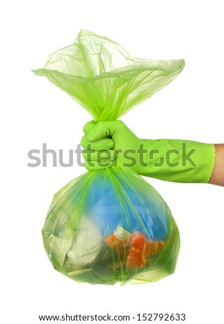 Hand holding a full garbage bag - stock photo