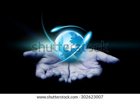 hand holding a glowing globe. - stock photo